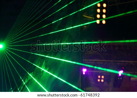 laser show on a fate concert - stock photo