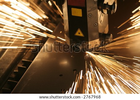 Lasercutting close-up from metalwork industry. - stock photo