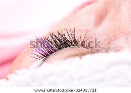 Lash making process, extreme long lashes with closed eye, woman eyelash extension. Macro shot, shallow depth - stock photo
