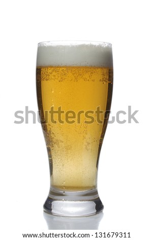 lass of beer over a white background. Cold fresh yellow tasty