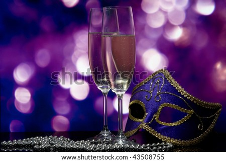 lasses with champagne and Venetian mask - stock photo