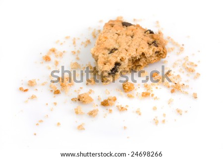 Last bite of a chocolate chip cookie with crumbs - stock photo