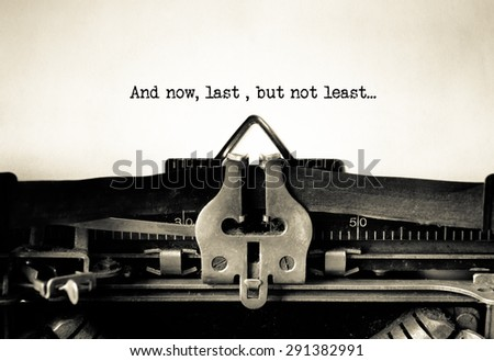 Last but Not the least typed words on a Vintage Typewriter  - stock photo