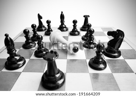 Last chessman defeated by overwhelming force. - stock photo