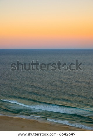 Last colors of sunset after sun has gone down over the ocean at Surfer's Paradise, on the Gold Coast, Queensland, Australia
