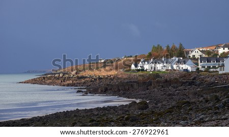 Last light over a remote croft on the coast in the Scottish Highlands, Scotland,UK. - stock photo