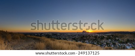 Last-minute scouting led to this fantastic viewpoint overlooking the metropolis of Los Angeles. This captures the moment of sunset. - stock photo
