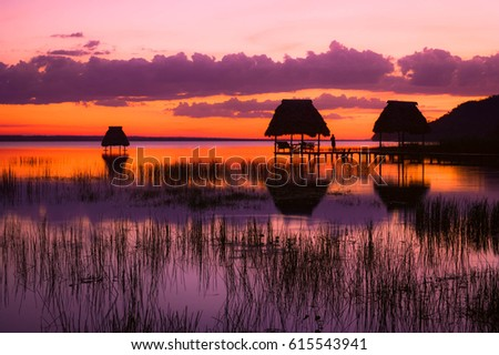 Last minutes of sunset at the lake Peten Itza in El Ramate, Guatemala. Central America