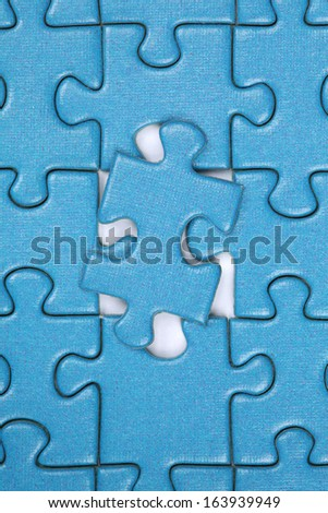 Last piece in a jigsaw puzzle, concept problem solution and strategy - stock photo