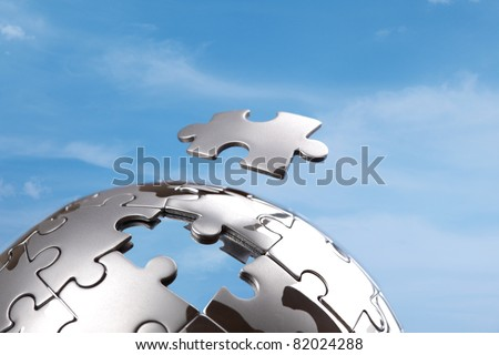 Last piece of a global puzzle concept for business solutions and strategy - stock photo