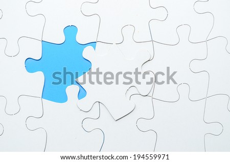 Last piece of jigsaw puzzle - stock photo