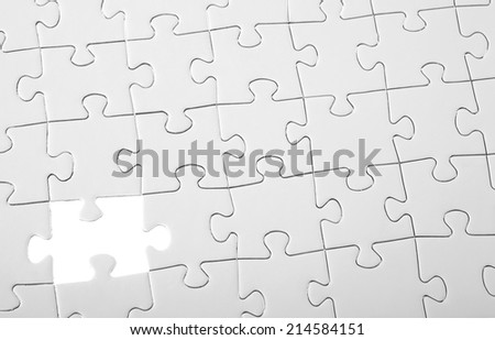Last piece of white puzzle - stock photo