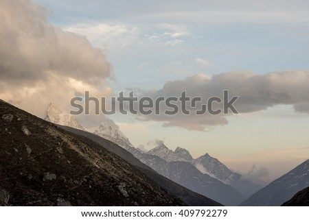 Last rays of the sun in the clouds - onthe way to Gokyo region, Nepal, Himalayas