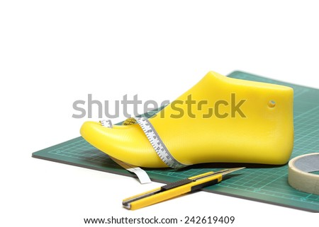 Last shoe and equipment used in shoe design on white background , focuses on the last shoe.(with clipping path) - stock photo