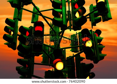 Last traffic light in Eilat (Israel) on the colorful sunset background. Eilat is a city without traffic lights. Instead of them - the squares. And it is a photo of the last traffic light of a city. - stock photo