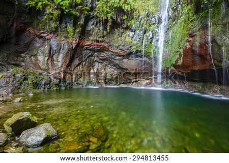 Last waterfall of the Twenty-five Fountains Levada hiking trail, Madeira (Portugal) - stock photo