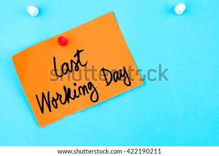 Last Working Day written on orange paper note pinned on cork board with white thumbtack, copy space available - stock photo