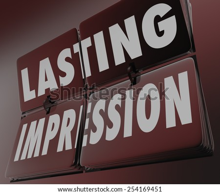 Lasting Impression words on flipping retro clock tiles to remind you of a memborable, unforgettable performance, work, job or task - stock photo