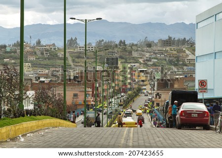 LATACUNGA, ECUADOR - APRIL 18: Ecuadorian ethnic people and traffic in the street on April 18, 2014 in Latacunga, Ecuador.