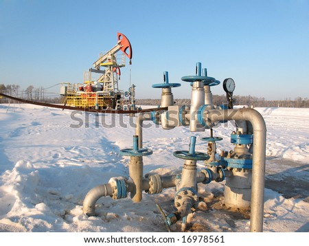 Latch on a oil well. Oil industry. Construction and mechanism in work. Mouth of the oil well. - stock photo