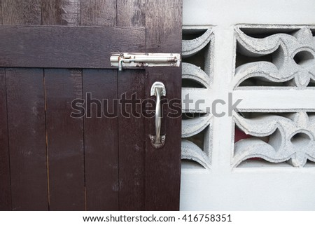 latch on a wooden door - stock photo