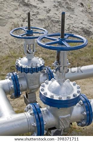 Latch on oil pipeline - stock photo
