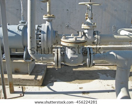 Latch on the pipeline. Oil refinery. Equipment for primary oil refining. - stock photo