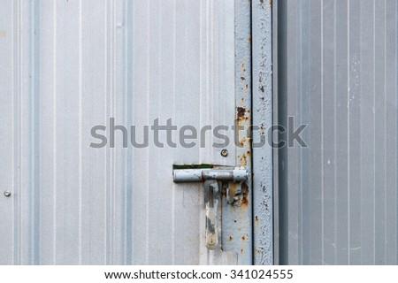 latch zinc door - stock photo