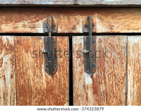 latches and hooks in wooden drawer,Metal bolts - stock photo