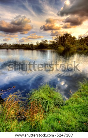 Late afternoon at the lake (high dynamic range, three exposures) - stock photo