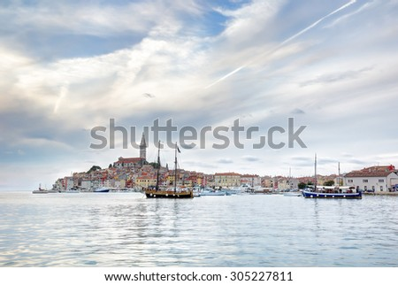 Late afternoon in the old Istrian town of Rovinj or Rovigno in the Adriatic Sea of Croatia with the Saint Euphemia's Basilica dominating the town. - stock photo