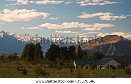 Late afternoon in winter looking over the Remarkable Ranges near Wanaka, New Zealand - stock photo