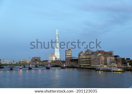 Late afternoon sun lights up the London skyline. The Shard is the tallest skyscraper in Western Europe. The Tower block to the right is Guy's Hospital - stock photo