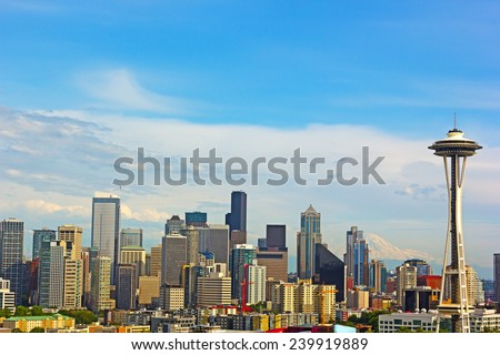 Late afternoon sun touched Seattle city skyline. Seattle city landmarks and Mt. Rainier at sunset. - stock photo