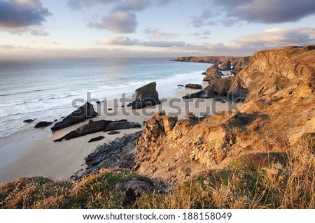 Late afternoon sunshine rakes across the dramatic coastal feature known as Bedruthan Steps, near Newquay in Cornwall. - stock photo