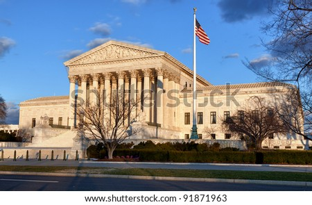 Late afternoon winter sun illuminates front of supreme court in Washington in winter - stock photo
