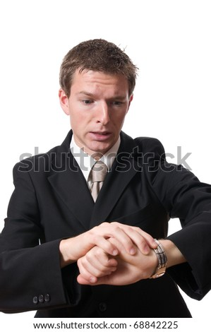 late businessman looking at his watch isolated on white backgroud - stock photo