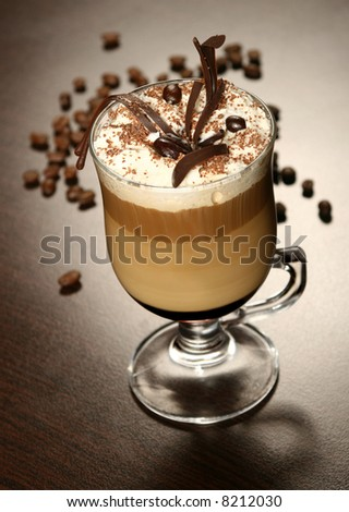 late coffee with chocolate and coffee grains - stock photo