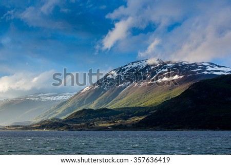 Late day sun shines on mountains surrounding Beaver Channel in Argentina - stock photo