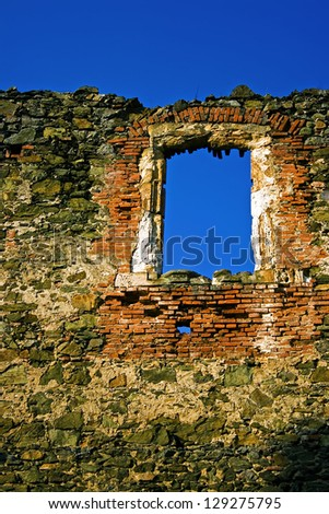 Late Gothic framing of the North Palace from Soimos castle (14th century). Situated on a hill nearby the european road E68 after the eastern entrance into the village Lipova,Romania. - stock photo