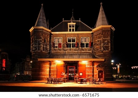 Late medieval building 'De Waag' in Amsterdam The Netherlands by night
