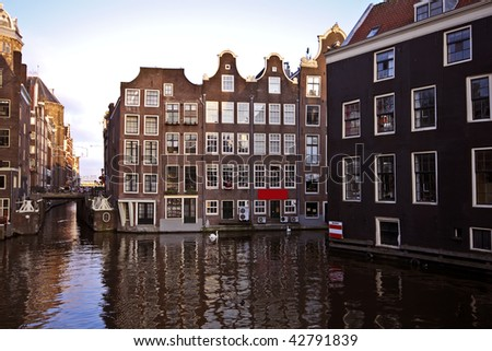 Late medieval houses along a canal in Amsterdam city the Netherlands