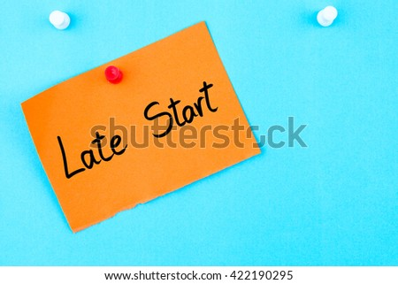 Late Start written on orange paper note pinned on cork board with white thumbtack, copy space available - stock photo