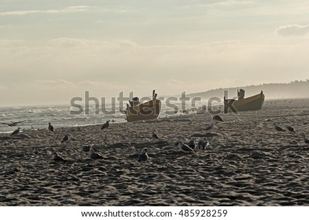 Late summer at the Baltic Sea, fishing boats on golden sandy beach in Poland