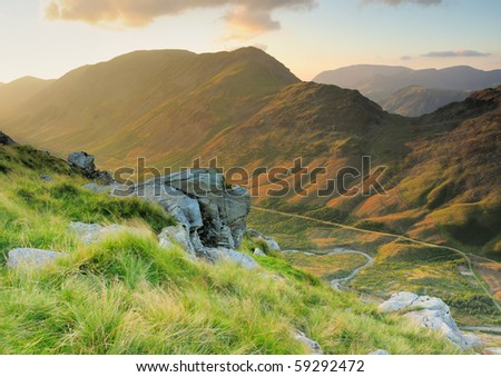 Late summer evening light over the Ennerdale Valley towards High Crag and Haystacks in the English Lake District - stock photo