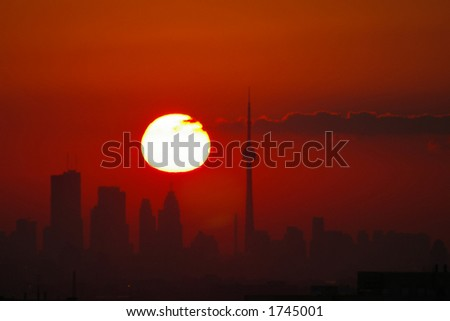 Late summer sunrise over the Toronto skyline with a few clouds - stock photo