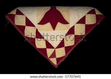 Late 19th century quilt, showing the wear and tear of the ages. - stock photo