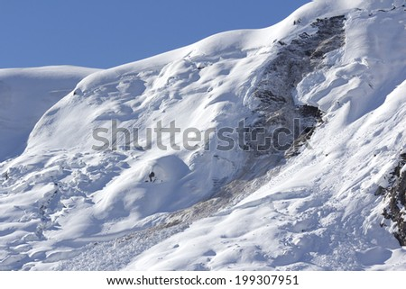 Late winter snow avalanche in italian alps. - stock photo