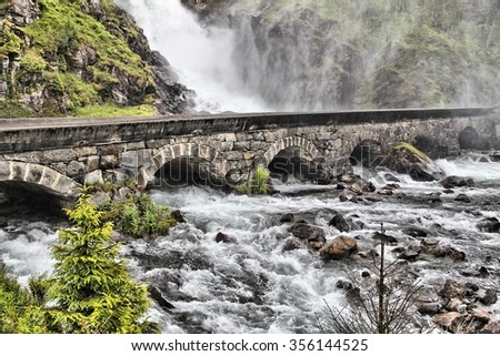 Latefossen waterfall in Hordaland, Norway. Old stone bridge.