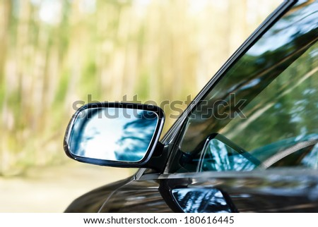 Lateral rear-view mirror of the car - stock photo